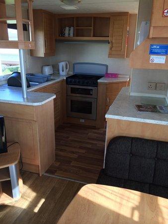 Barmston Beach Holiday Park - Park Resorts: Kitchen area in bronze