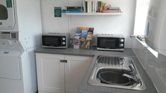 Higher Moor Farm: Laundry room (microwaves for guest's use)