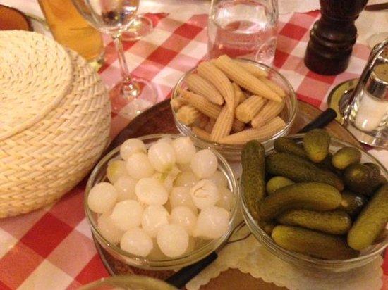 Raclette Stube: Potatoes in basket, cornichons etc for the raclette