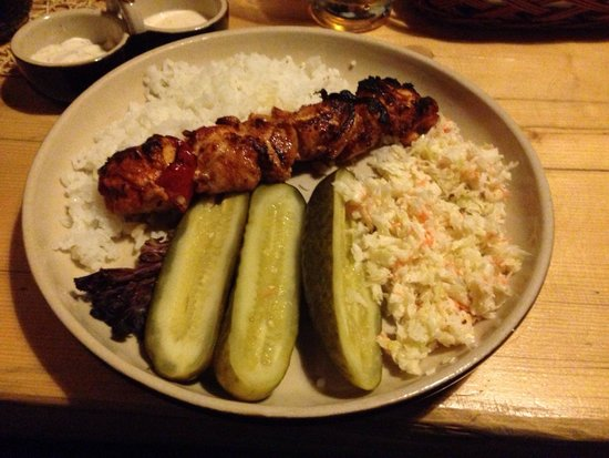 Chata: Meat kebab, pickled cucumbers, rice and coleslaw