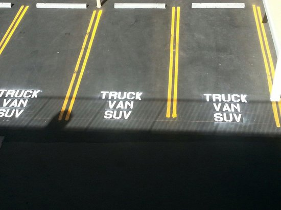 Courtyard parking spaces re-striped and marked for Trucks