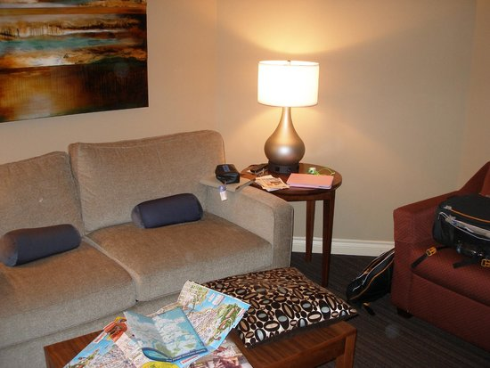 VI at Rosedale on Robson: Living room: sofa, armchair, good lighting, TV, desk, phone