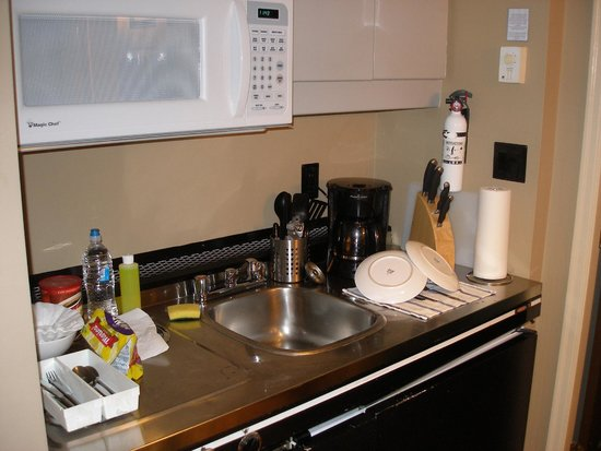 VI at Rosedale on Robson: Kitchen: microwave, stove top, sink, coffee maker, fridge, utensils