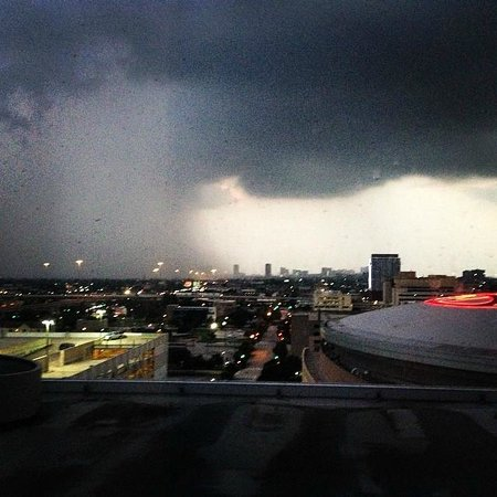 Hilton Americas - Houston: Watching a storm roll in from room