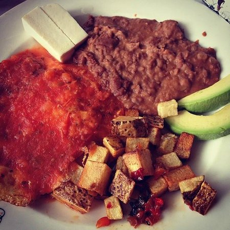 Macondo Bistro: Platillo Arcadio: two eggs over hard with refried beans, fresh avocado, potatoes, and queso fres