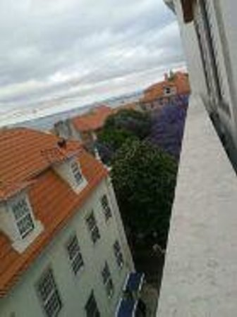 Lisboa Carmo Hotel: Rooftops viewView from room to ocean