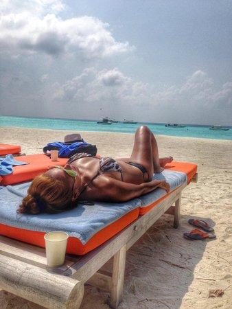 Club Med Kani : Sunbathing by the beach.