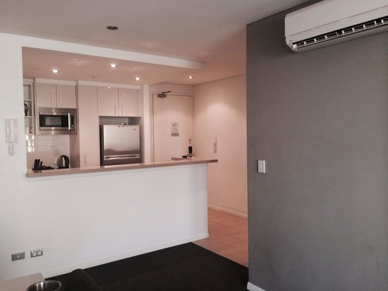 Meriton Serviced Apartments - Broadbeach: Kitchen from couch.