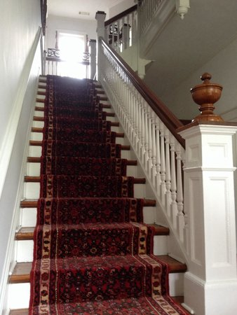 Jackie O' House: The beautiful staircase leading up to the second floor suites.