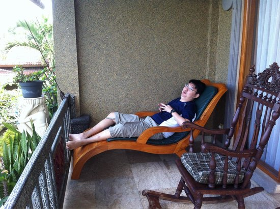 Cendana Resort and Spa: The balcony also contains a recliner and a rocking chair perfect for two people to chill by the