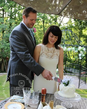 Cutting our Wedding Cake provided by Red Bud Manor