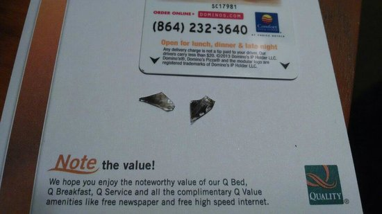 Quality Inn & Suites: Broken crack pipe glass found near bed.