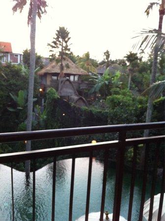 Komaneka at Rasa Sayang: View of the swimming pool below and beyond villa from the restaurant