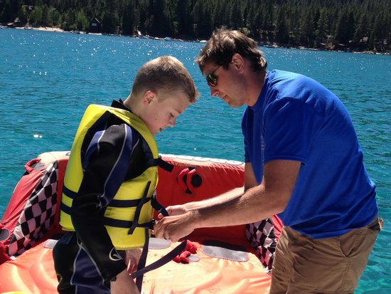 Lake Tahoe Boat Rides: Captain Steve making sure the kids were suited up and safe!