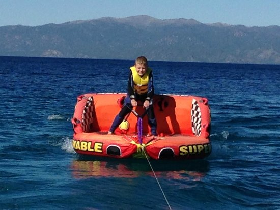 Lake Tahoe Boat Rides: Captain Steve giving our son some lessons about waterskiing. First trying it on the tube!