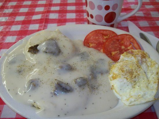 Neva General Store : my fav breakfast/ hot coffee, biscuit with sausage gravy, fried egg and sliced tomato