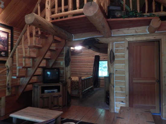 The Old Mill Log Cabins : Open the door and look inside