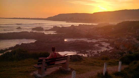 Hermanus Beach Villa: My wife enjoying the sunset.  Short walk from HBV