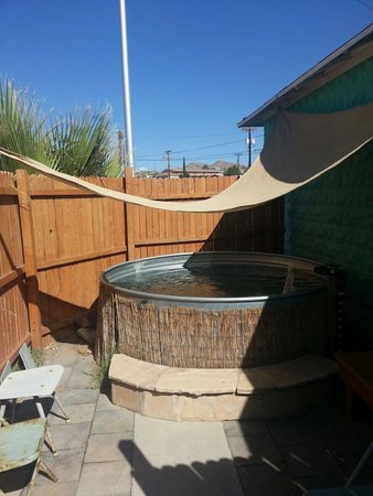 Fire Water Lodge: Your private tub, under the stars with a removable canopy for daytime shade, and chairs/benches