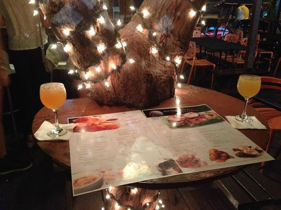 Moons Bar & Tapas: Seating by the tree with delicious sangria.