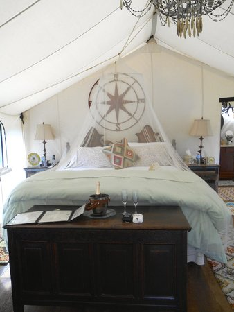 The Depot Lodge: Bed inside glamping tent