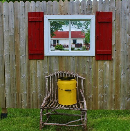 The Maroon Pig Art Gallery and Sweet Shop : Window in a fence