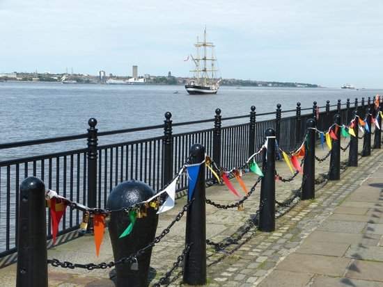 Walking infront of Albert Dock, with padlocks on the chains