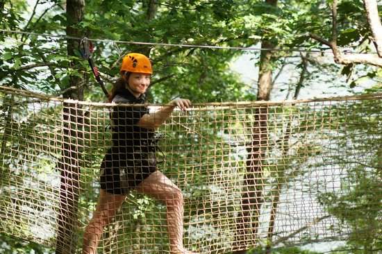 Canopy Challenge Course at Fall Creek Falls State Park a leisurely traverse on the V & a leisurely traverse on the V-Bridge with Fall Creek Falls Lake in ...