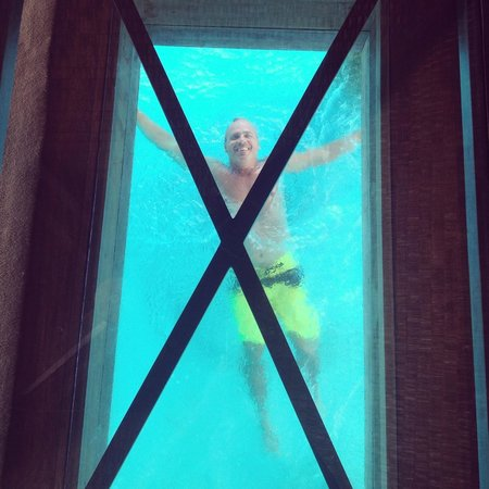 The St. Regis Bora Bora Resort: Swimming under the glass under water viewing table
