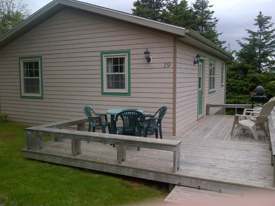 Fairways Cottages: Outside. Large deck with BBQ