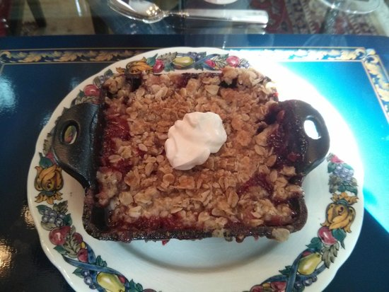 The Butler House Historic Bed and Breakfast: Fourth Course – Cast iron strawberry rhubarb crumble, topped with crème fraiche