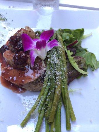 Tony Stella's Encore: Pork tenderloin with luscious cheeses, Grand Marnier cherry sauce, exquisite vegetables ,an edib