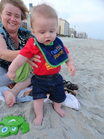 Roxanne Towers: Touching the sand for the first time.