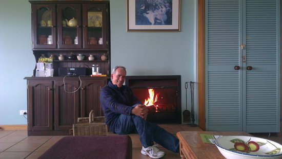 Sovereign Hill Country Lodge: hubby by the fire