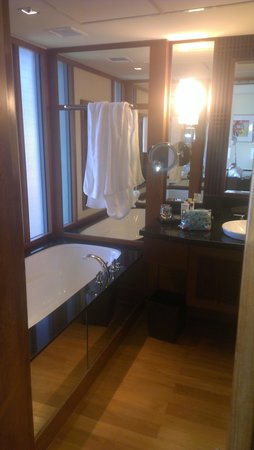 Sofitel Singapore Sentosa Resort & Spa: a stunning bathroom with huge tub and shower.