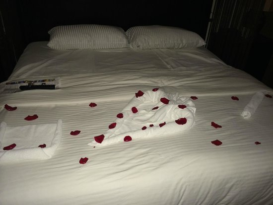 Secrets Wild Orchid Montego Bay: Thank you turn down service! I Love you spelled in towels covered with rose petals!