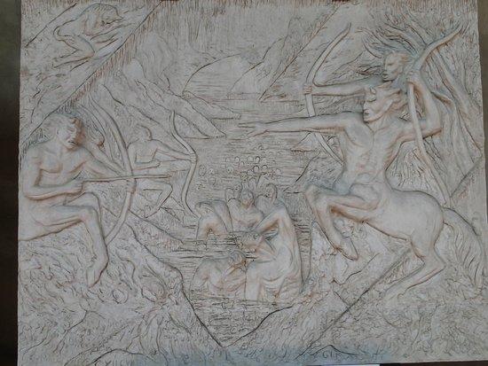 Basilica di Santa Croce: Scene from the Inferno on outside wall