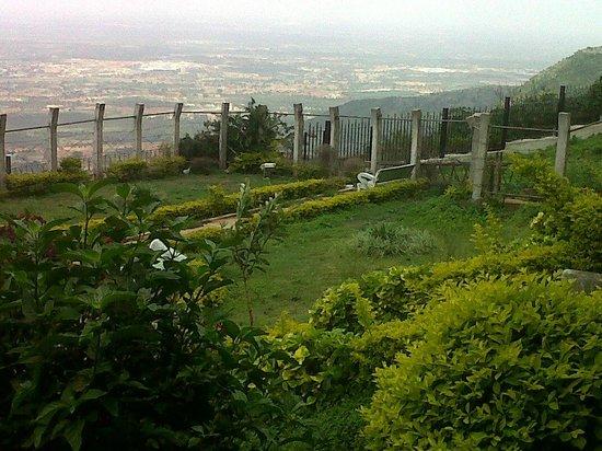 VIEW OF THE FLAT LAND BELOW FROM ATOP NANDI HILLS, HOTEL MAYURA