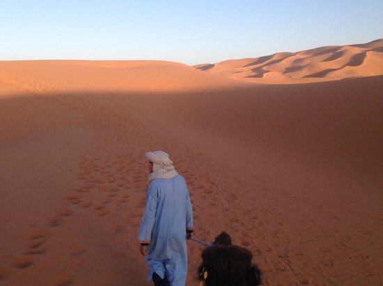 Morocco Countryside Tours: Being led out to the desert campsite (glam-site) at sunset