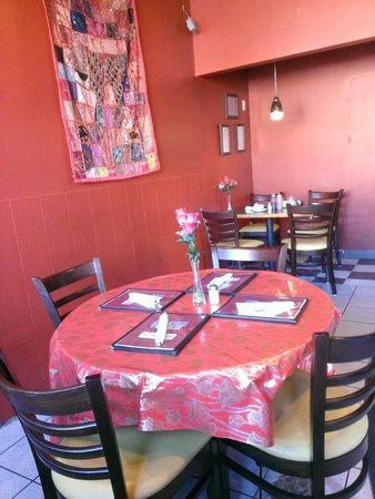 Taj Indian Restaurant: Cozy interior has a few tables and bar stools along the window.