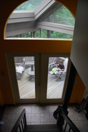 The Homestead: view of screened porch from upper loft