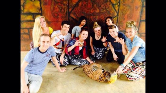 Tiger Temple ( Wat Pa luang Ta Bua) : Group Photo of us playing with the cubs.