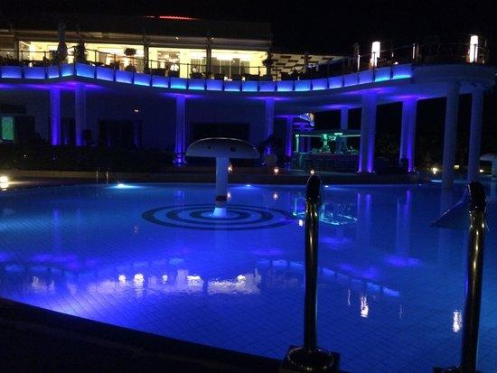 Royal Heights Resort: main building & pool at night