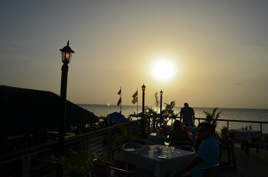 The Cracked Conch by the Sea: View of sunset from outdoor seating area
