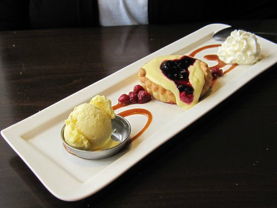 Simplicity Bistro: Lemon tart with raspberry coulis and blueberry preserve