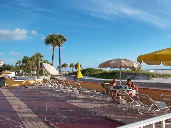 Page Terrace Beachfront Hotel : Shuffleboard, lounge chairs, and grill