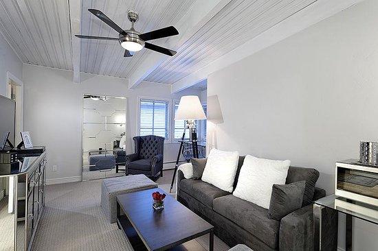 Little Red Ski Haus : Living Room of Magnifico Suite facing Aspen Mountain, Desk Area