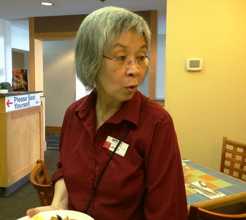 "Park Inn & Suites by Radisson: Janice, who is a server in the coffee shop.  Here she is saying ""I love making people happy!"""