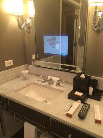 Waldorf Astoria Chicago: TV in the mirror, pretty useful :)