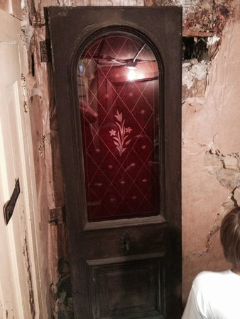 Home of Stone: The original doors of the home were made of cranberry glass.